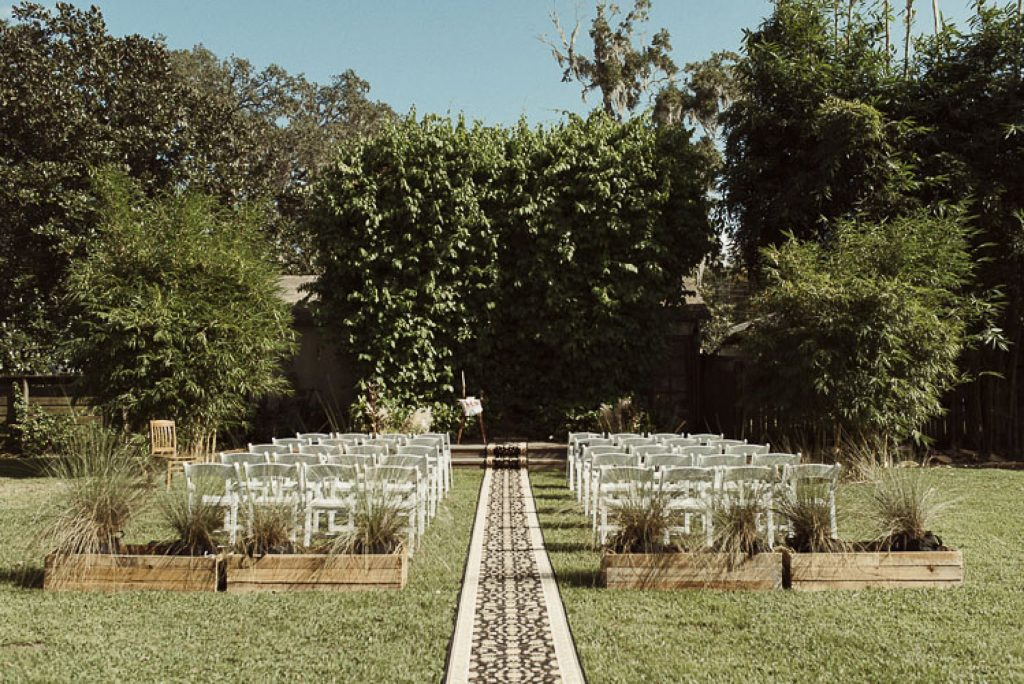 outdoor wedding venue with chairs and a aisle runner