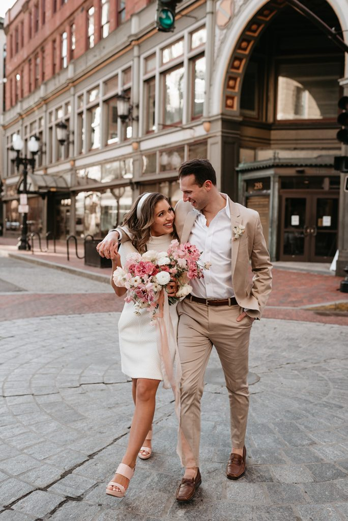 bride and groom walking downtown