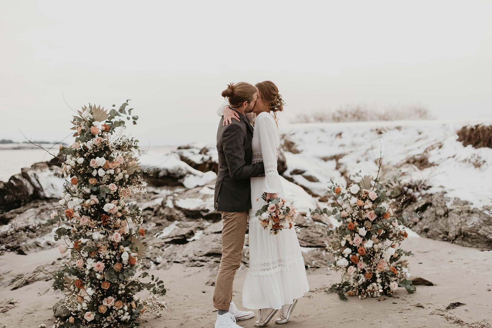 bride and groom getting married on beach