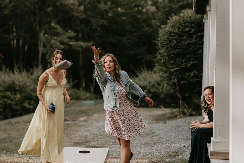 wedding guests playing cornhole