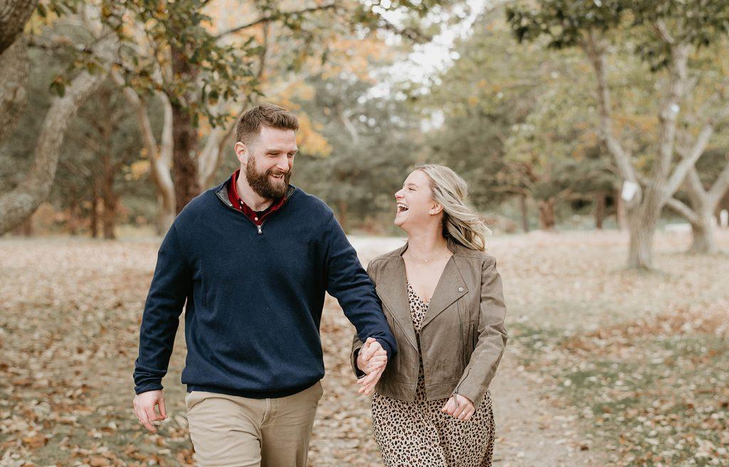 couple walking in the fall foliage
