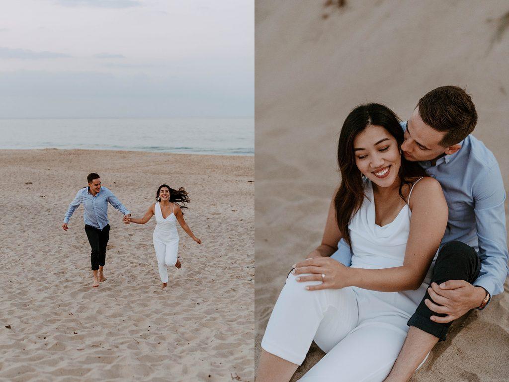 couple embracing on sand dunes